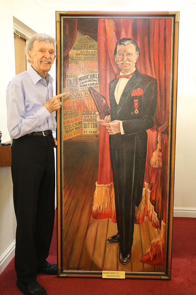 Mark Raffles with his life-sized portrait